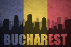 Abstract silhouette of the city with text Bucharest at the vintage romanian flag Royalty Free Stock Images