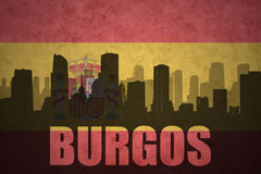 Abstract silhouette of the city with text Burgos at the vintage spanish flag Royalty Free Stock Images