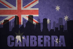 Abstract silhouette of the city with text Canberra at the vintage australian flag vector illustration