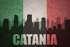 Abstract silhouette of the city with text Catania at the vintage italian flag Royalty Free Stock Photo