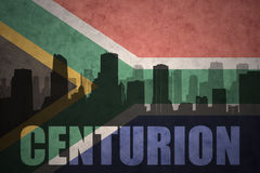 Abstract silhouette of the city with text Centurion at the vintage south africa flag. Background Stock Photos