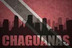 Abstract silhouette of the city with text Chaguanas at the vintage trinidad and tobago flag Stock Photo