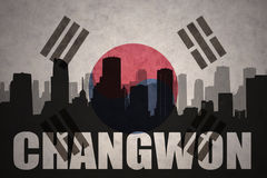 Abstract silhouette of the city with text Changwon at the vintage south korea flag. Background royalty free stock images