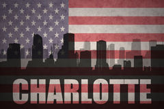 Abstract silhouette of the city with text Charlotte at the vintage american flag Royalty Free Stock Photo