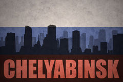 Abstract silhouette of the city with text Chelyabinsk at the vintage russian flag. Background Royalty Free Stock Photo