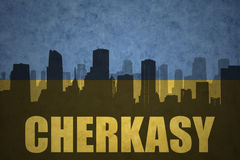 Abstract silhouette of the city with text Cherkasy at the vintage ukrainian flag. Background stock images
