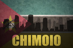 Abstract silhouette of the city with text Chimoio at the vintage mozambican flag. Background Royalty Free Stock Photos