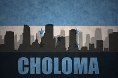 Abstract silhouette of the city with text Choloma at the vintage honduras flag. Background royalty free stock image