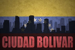 Abstract silhouette of the city with text Ciudad Bolivar at the vintage venezuelan flag Royalty Free Stock Photos