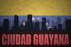 Abstract silhouette of the city with text Ciudad Guayana at the vintage venezuelan flag Royalty Free Stock Photo