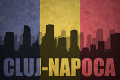 Abstract silhouette of the city with text Cluj-Napoca at the vintage romanian flag Stock Photography