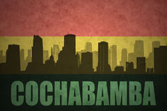 Abstract silhouette of the city with text Cochabamba at the vintage bolivian flag Royalty Free Stock Photos