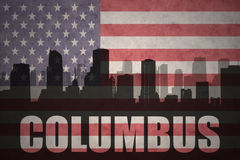 Abstract silhouette of the city with text Columbus at the vintage american flag Stock Photography