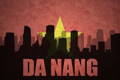 Abstract silhouette of the city with text Da Nang at the vintage vietnamese flag Royalty Free Stock Photography