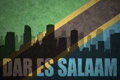 Abstract silhouette of the city with text Dar es Salaam at the vintage tanzanian flag Royalty Free Stock Image