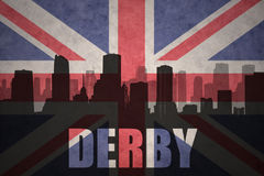 Abstract silhouette of the city with text Derby at the vintage british flag. Background Stock Photography