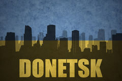 Abstract silhouette of the city with text Donetsk at the vintage ukrainian flag Royalty Free Stock Photography