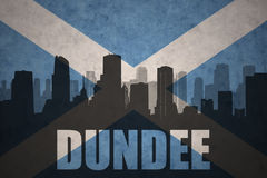 Abstract silhouette of the city with text Dundee at the vintage scotland flag Stock Photo