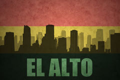 Abstract silhouette of the city with text El Alto at the vintage bolivian flag Royalty Free Stock Photos