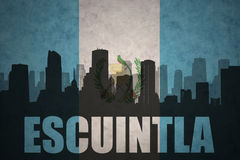 Abstract silhouette of the city with text Escuintla at the vintage guatemalan flag Stock Photo