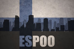 Abstract silhouette of the city with text Espoo at the vintage finnish flag. Background Royalty Free Stock Photo