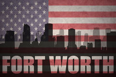 Abstract silhouette of the city with text Fort Worth at the vintage american flag. Background royalty free stock image