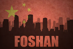 Abstract silhouette of the city with text Foshan at the vintage chinese flag. Background Royalty Free Stock Photo