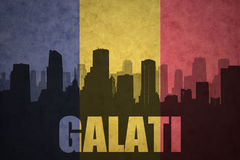 Abstract silhouette of the city with text Galati at the vintage romanian flag Stock Images