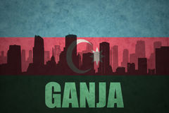 Abstract silhouette of the city with text Ganja at the vintage azerbaijan flag. Background royalty free stock images