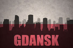 Abstract silhouette of the city with text Gdansk at the vintage polish flag Royalty Free Stock Photo