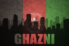 Abstract silhouette of the city with text Ghazni at the vintage afghanistan flag. Background Royalty Free Stock Photos