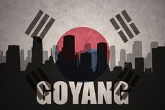 Abstract silhouette of the city with text Goyang at the vintage south korea flag. Background royalty free stock image