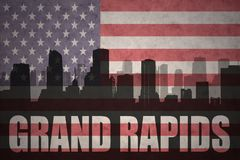 Abstract silhouette of the city with text Grand Rapids at the vintage american flag Stock Photos