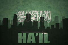Abstract silhouette of the city with text Ha`il at the vintage saudi arabia flag Stock Image