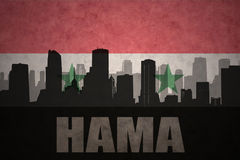 Abstract silhouette of the city with text Hama at the vintage syrian flag Stock Photo