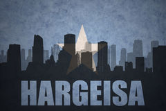 Abstract silhouette of the city with text Hargeisa at the vintage somalia flag royalty free illustration