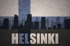Abstract silhouette of the city with text Helsinki at the vintage finnish flag. Background Royalty Free Stock Image