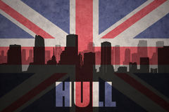 Abstract silhouette of the city with text Hull at the vintage british flag Stock Image