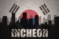 Abstract silhouette of the city with text Incheon at the vintage south korea flag. Background royalty free stock images
