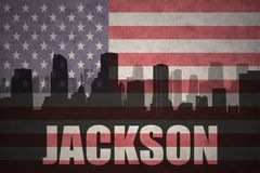 Abstract silhouette of the city with text Jackson at the vintage american flag. Background Stock Photos
