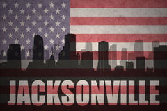 Abstract silhouette of the city with text Jacksonville at the vintage american flag Stock Image