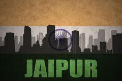 Abstract silhouette of the city with text Jaipur at the vintage indian flag. Background Royalty Free Stock Photo
