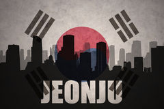 Abstract silhouette of the city with text Jeonju at the vintage south korea flag. Background royalty free stock photography