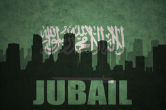 Abstract silhouette of the city with text Jubail at the vintage saudi arabia flag. Background Royalty Free Stock Image