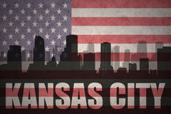 Abstract silhouette of the city with text Kansas City at the vintage american flag Stock Photography