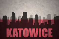 Abstract silhouette of the city with text Katowice at the vintage polish flag Royalty Free Stock Image