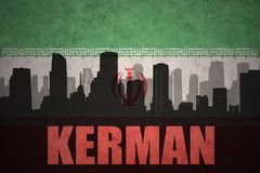 Abstract silhouette of the city with text Kerman at the vintage iranian flag. Background Stock Photography