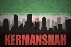 Abstract silhouette of the city with text Kermanshah at the vintage iranian flag. Background Stock Photo
