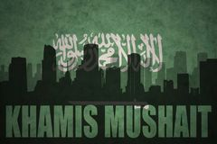 Abstract silhouette of the city with text Khamis Mushait at the vintage saudi arabia flag Royalty Free Stock Photo