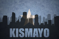 Abstract silhouette of the city with text Kismayo at the vintage somalia flag. Background Stock Photography